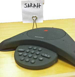speakerphone-with-sign